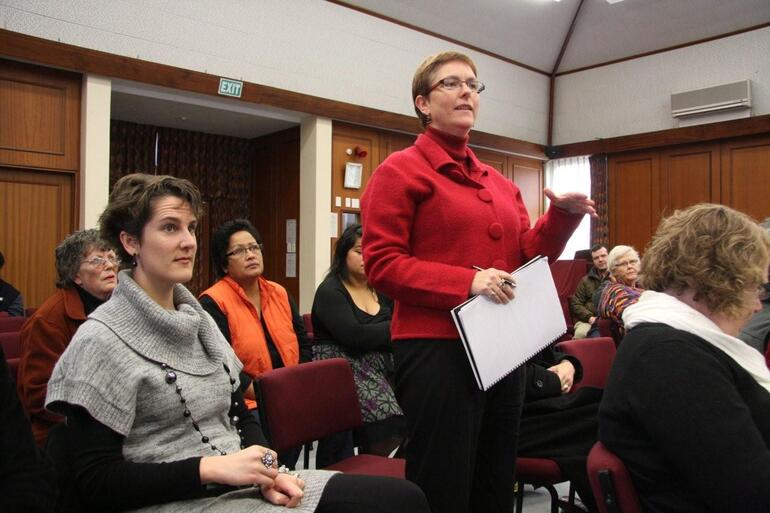 The Rev Helen Jacobi, Dean of St John's Cathedral in the Diocese of Waiapu, puts a question to Bishop Katharine.