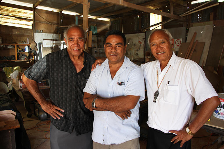 Archdeacon Joe Le'ota, left, and Archbishop Winston Halapua flank Tevita Hikila, who owns the workshop where the furniture was finished.
