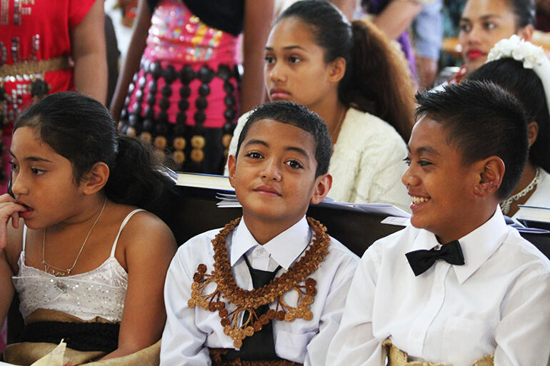 Confirmation candidates Sisilia Evelini Faletau (left) Geoffrey Talanoa and Willis Halaapiapi, with K.Faletau at the back, awaiting their moment.