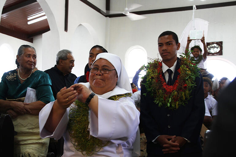 Sr Fehoko, of Nuku'alofa's Community of the Sacred Name, leads Saturday's gospel procession, with Kolini Hiko beside her.