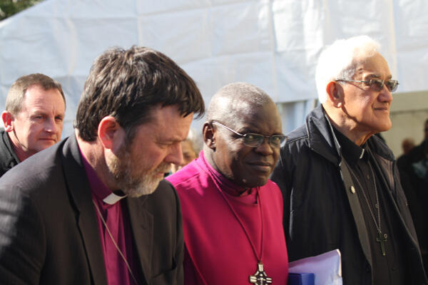 The Archbishop of York is called on to the marae, flanked by Bishop Philip Richardson and Archdeacon Tiki Raumati.