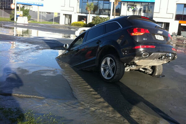 A car sinks into liquefaction following the latest aftershocks in Christchurch. Photo: Tim Kelleher