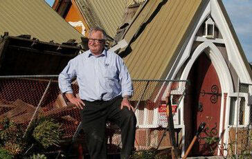 The Rev Neil Struthers contemplates the fate of Lyttelton's Holy Trinity Anglican Church. Photo: Greg Bowker, NZ Herald