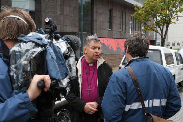 A TV journalist quizzes Archbishop David Moxon on the place of God in such devastation.