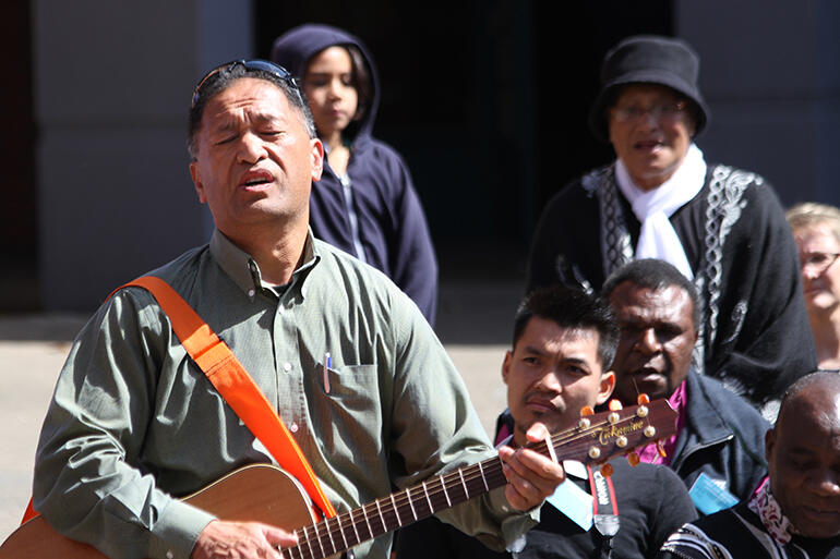 Heartfelt music: John Tapiata leads a waiata for the overseas manuhiri.