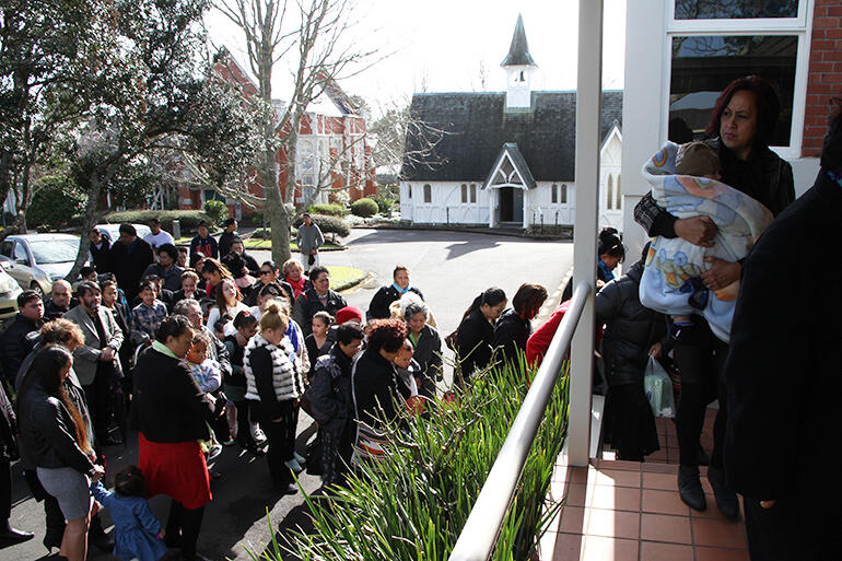 The manuhiri are called into the powhiri for the new students. They brought plenty of supporters.