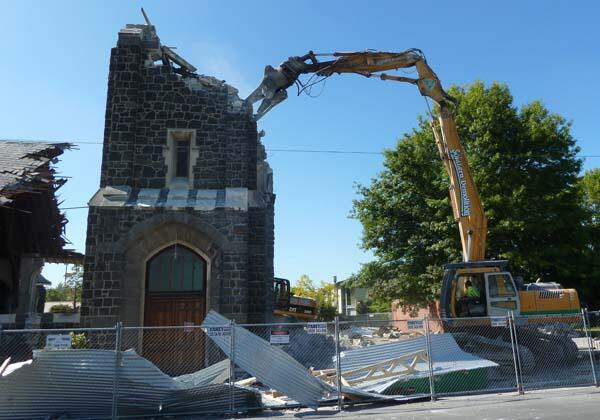 The demolition machine lays waste to the tower of St Mary's, Merivale.