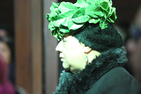 One of kaikaranga, wearing her wreath of puririri leaves, who called mourners into the church.