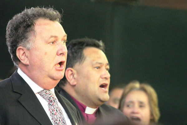 Shane Jones and Bishop Kito leading a waiata.