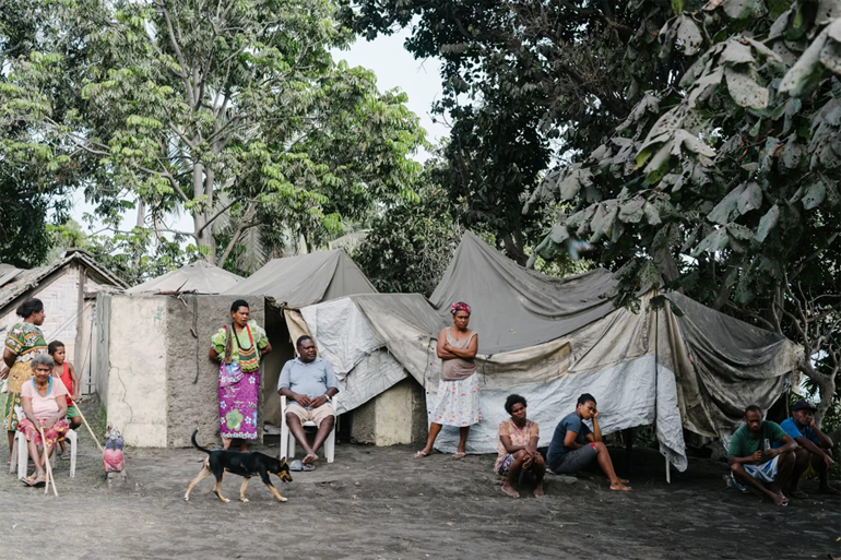 Ambae Islanders with ash-covered tents after the volcanic eruptions. In 2019-2020 Ambae Islanders need help to rebuild and prepare for cyclones.