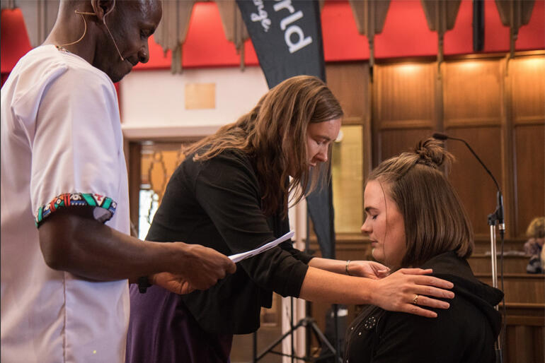 Bishop Eleanor Sanderson and Steve Maina pray for Anna Smart as she heads into the Better World gap year.