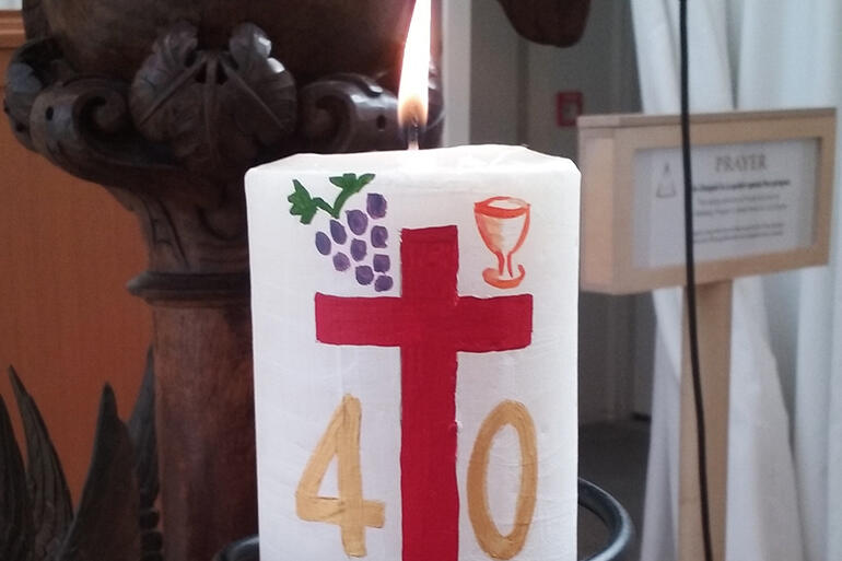 Close-up of a 40th anniversary candle made for the Transitional Cathedral by Elizabeth Kimberley.