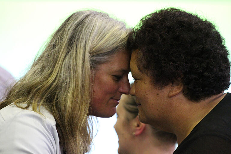 Jax Clark and the Rev Hannah Pomare - who is a Youth Commissioner - exchange hongi.