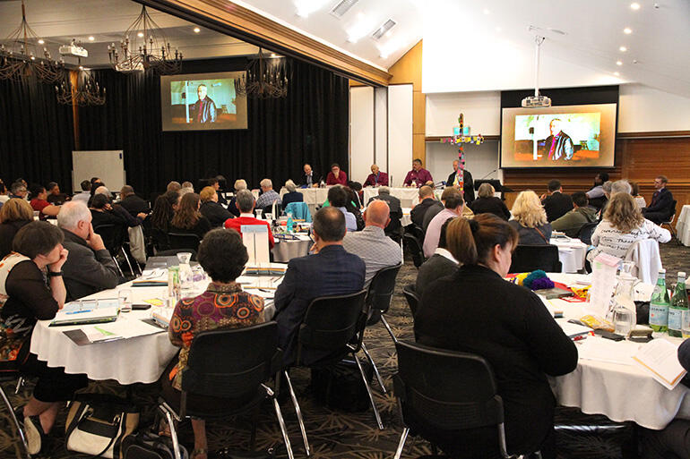 Synod listens to the video report from Bishop Richard Ellena.