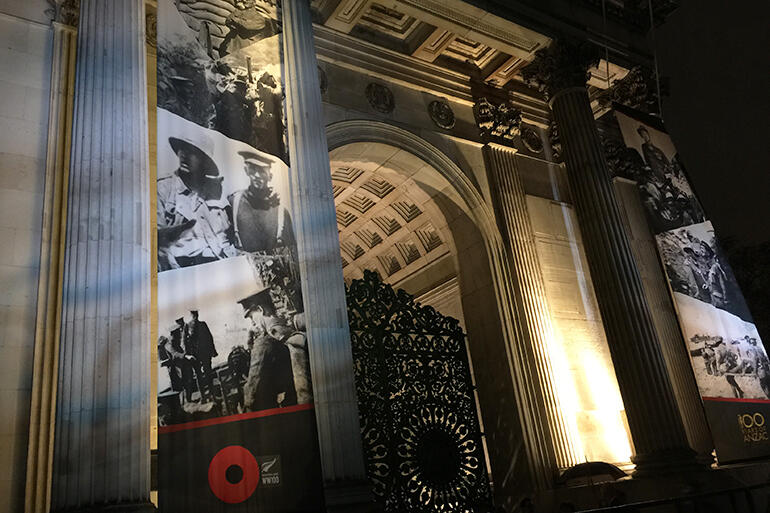 3am in Hyde Park in London on Anzac Day 2015 - and images of ANZAC soldiers are projected against The Wellington Arch.