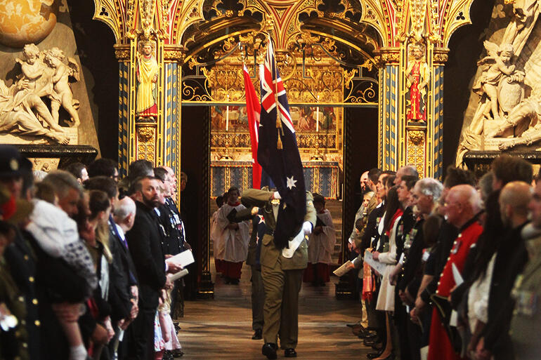 Honour for sacrifices past, hope for the future: the flags of New Zealand, Turkey, the UK and Australia being brought into Westminster Abbey.