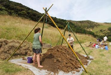 Archaeologists and students from the University of Otago excavating the site of the missionary settlement, just above the Marsden Cross.