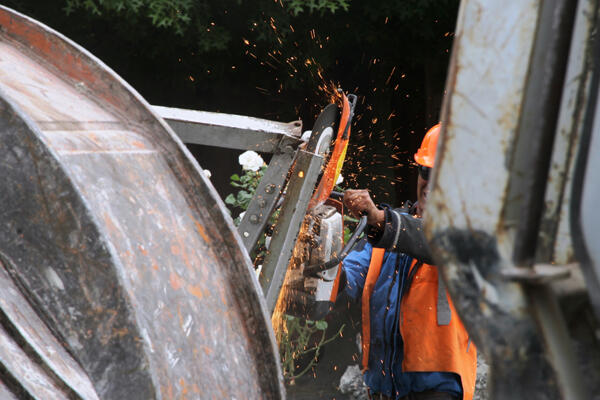 A demolition worker cuts up the fallen bell frame at St Mary's in Merivale. Photo: Lloyd Ashton