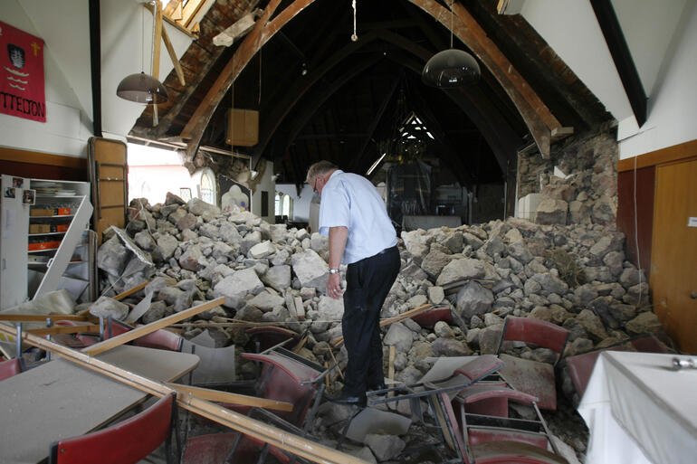 Lyttelton's vicar, Neil Struthers, picks through the rubble of Holy Trinity. Photo: Kirk Hargreaves/The Press.
