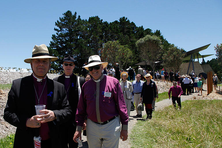 Archbishops David Moxon, Philip Freier of Australia, and Bishop Richard Randerson on the path down from Rore Kahu.