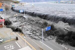 The tsunami crashes over a street in Miyako City in north-eastern Japan. Photo: Reuters