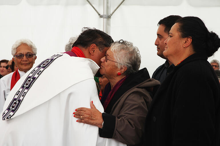 Whaea Mihi blesses the new bishop of Te Tairawhiti, with her daughter Jan and grandson Nehe in support.