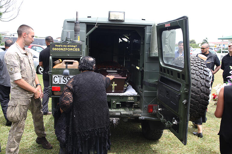 Archbishop Brown was loaded into an Army vehicle for his final journey.