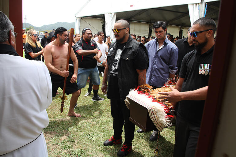 As the pallbearers were about to pass through the waharoa, the haka rang out.