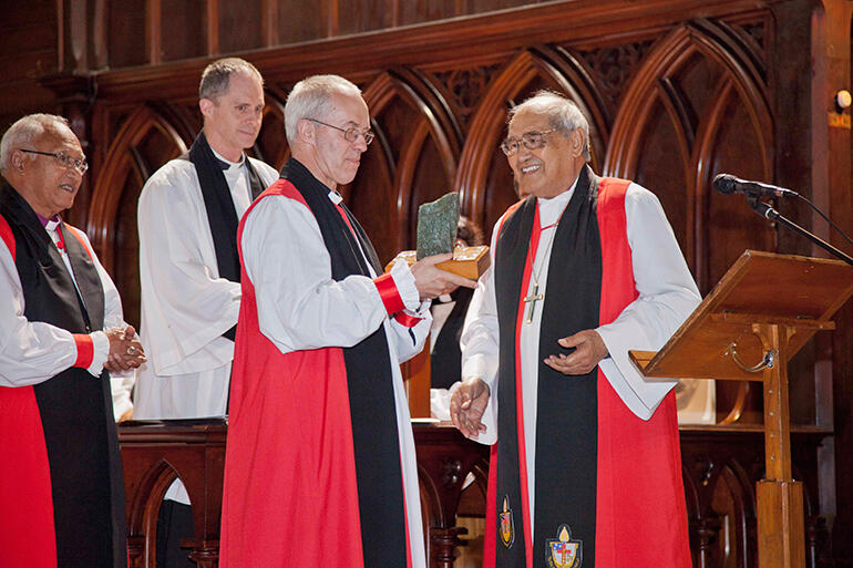 Archbishop Brown Turei presents Archbishop Welby with a gift of pounamu, or precious New Zealand jade, mounted on a plinth.