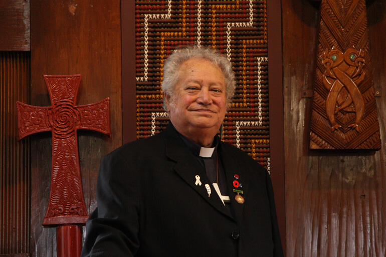The Ven Richard Wallace stands at the altar in the chapel of Te Waipounamu diocesan centre in Otautahi.