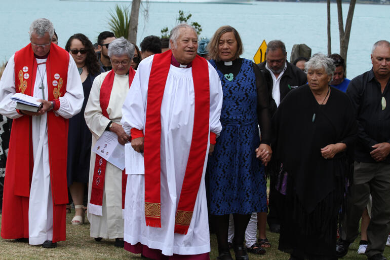 Bishop-elect Richard walks on to Onuku with his wife Mere and whanau.