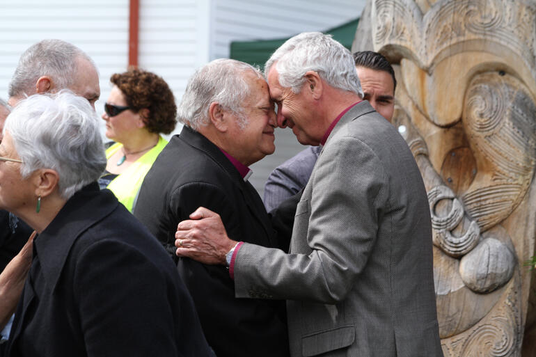 Bishop Richard greets Bishop-elect Richard in the powhiri.