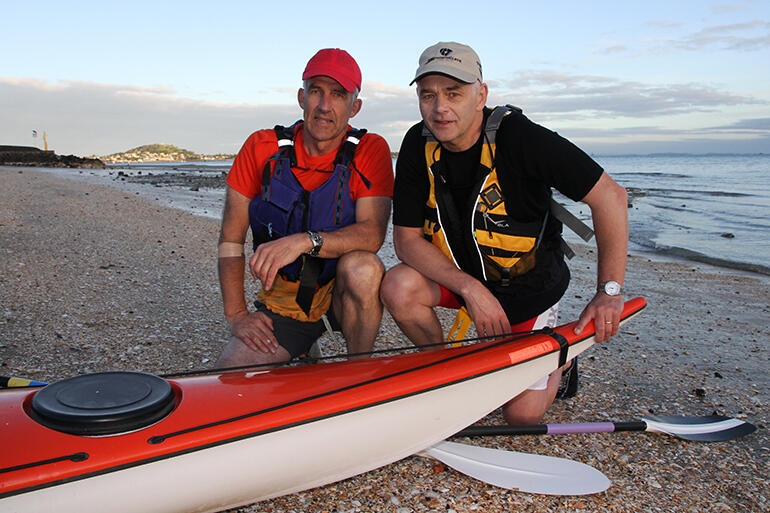 John Tuke and Bishop Jim White pause before beginning their marathon paddle from Mission Bay to Oihi Beach.