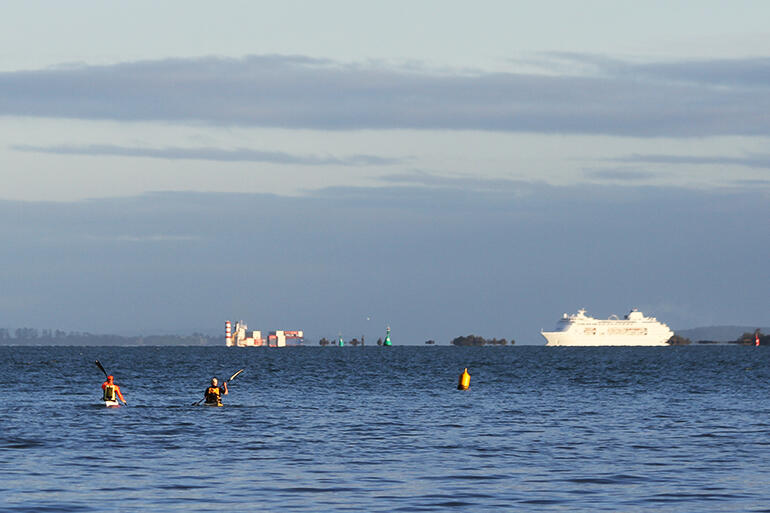 Who gives way to whom? The cruise liner emerging from behind Rangitoto Island, bound for the Port of Auckland.
