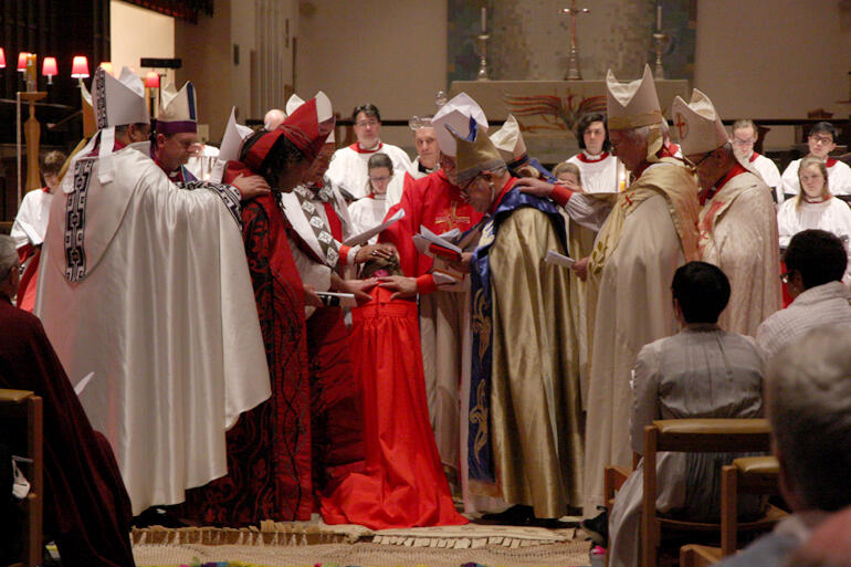 Eleanor Sanderson's new peers ordain her bishop in the laying on of hands.