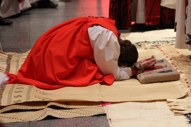 Veni Sancte Spiritus! Eleanor prays as she kneels on fine mats from Tonga and the people sing.