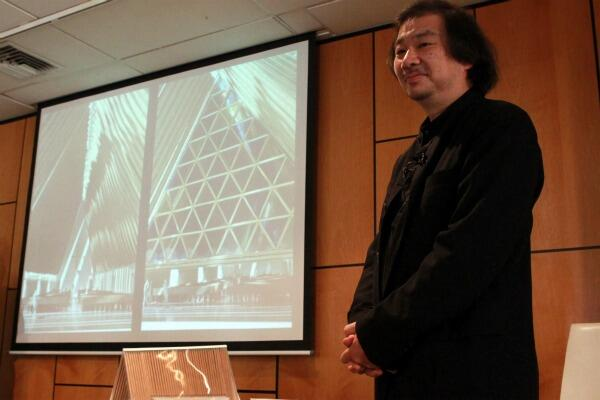 Japanese architect Shigeru Ban with a slide of his cardboard cathedral. Photo: The Press