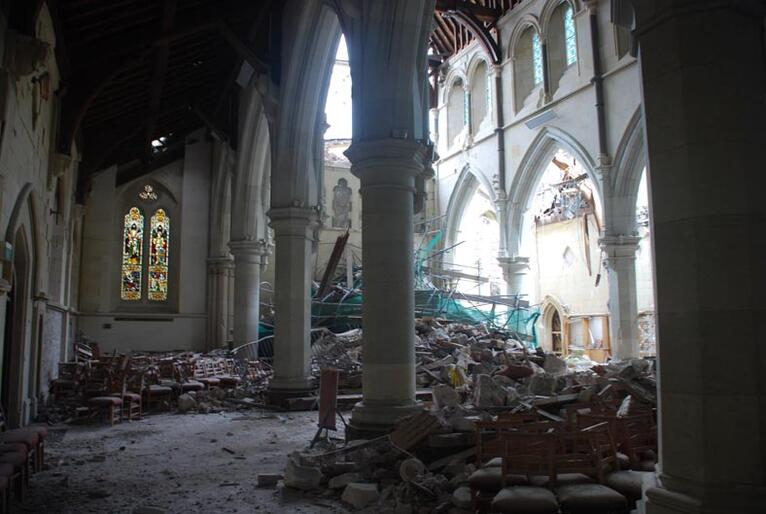 Looking west. The cathedral's main doors are submerged in rubble from the Rose Window.