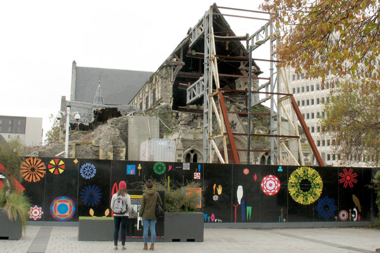 ChristChurch Cathedral stands behind hoardings in the square, April 2017.