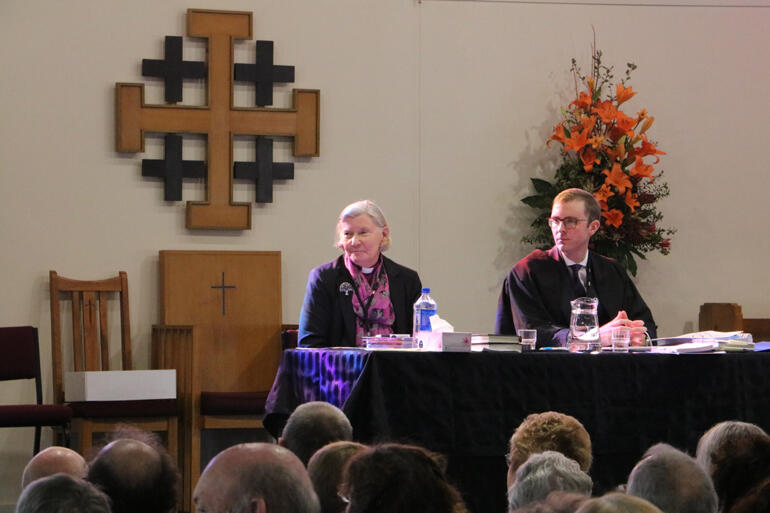 Bishop of Christchurch Victoria Matthews and Diocesan Chancellor Jeremy Johnson listen as synod debates cathedral options.