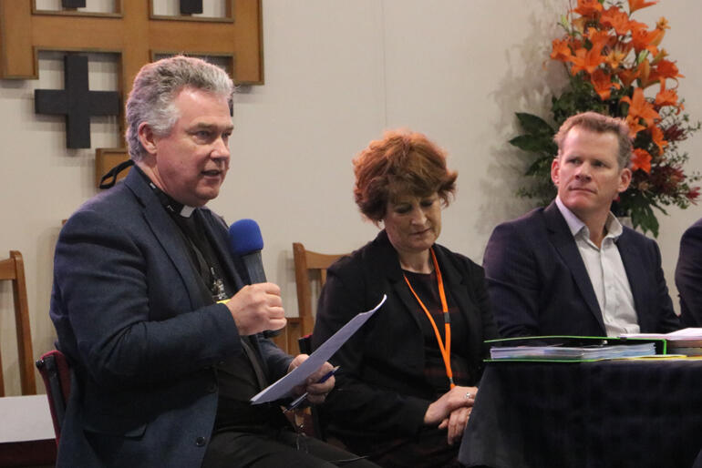 Dean Lawrence Kimberley talks to synod flanked by Suzanne Price and Richard Seville from CPT.