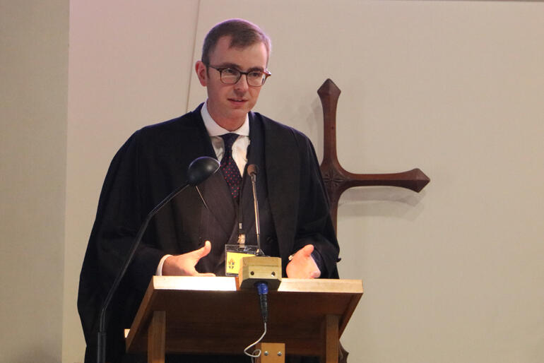 Diocesan Chancellor Jeremy Johnson takes synod through the voting procedures.