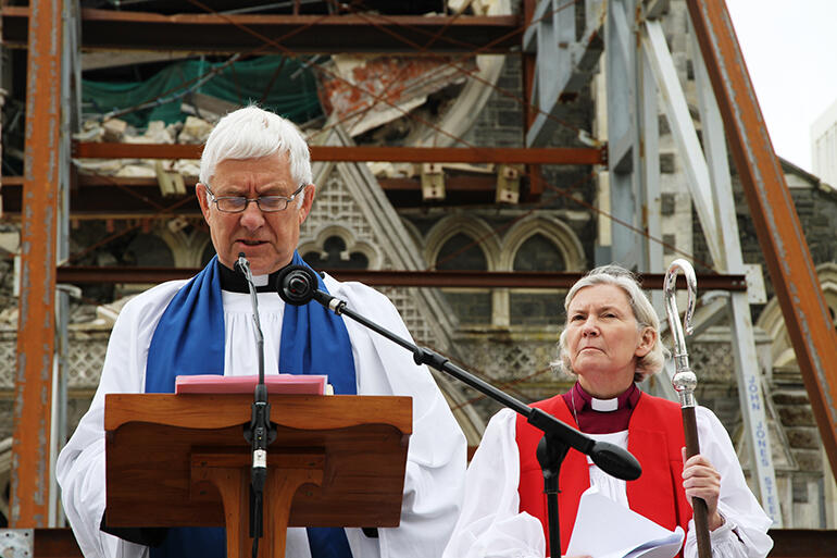November 2011: the then Dean, Peter Beck, and Bishop Victoria preside during the wrecked cathedral's deconsecration.