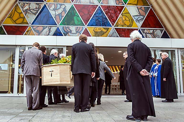 Dean Lynda Patterson's casket is taken into the Transitional Cathedral. Photo: John Kirk-Anderson/Fairfax NZ