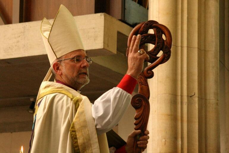 Dunedin's new Bishop bestows his blessing on the cathedral congregation.
