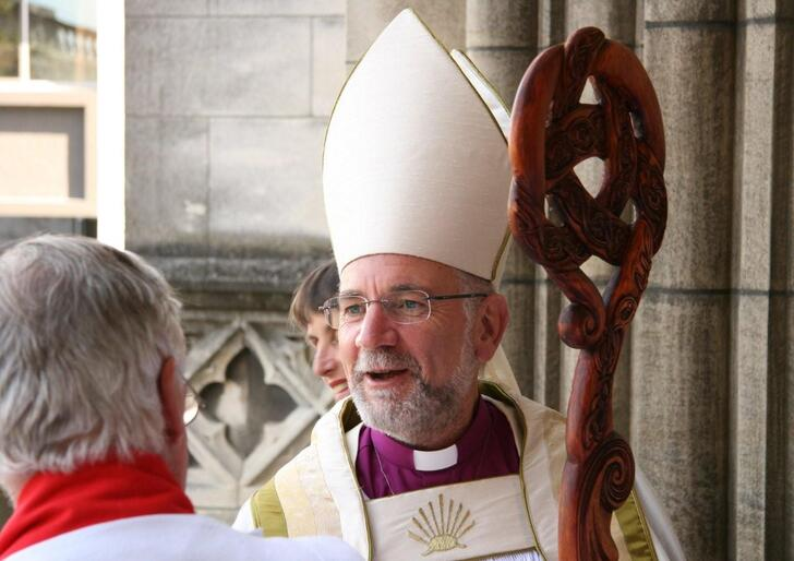 The bishop acknowledges a well-wisher.