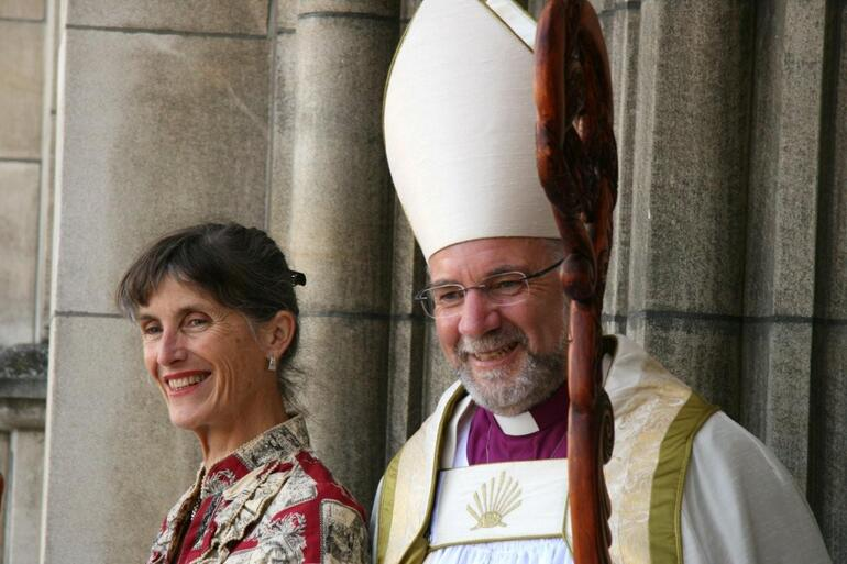 The new bishop and his wife respond to wellwishers outside the main entrance to the cathedral.