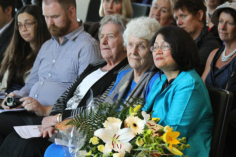 That's Archbishop David's wife, Tureiti Moxon, holding the bouquet, and his mother, Mrs Joan Moxon, beside her.