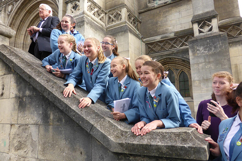 Students from St Hilda's Collegiate watch the royal walkabout from the steps of St Paul's Cathedral.