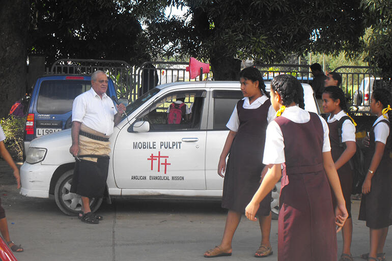 Bishop-elect 'Afa Vaka and his mobile pulpit. Often, he preaches in settings more turbulent than this one.